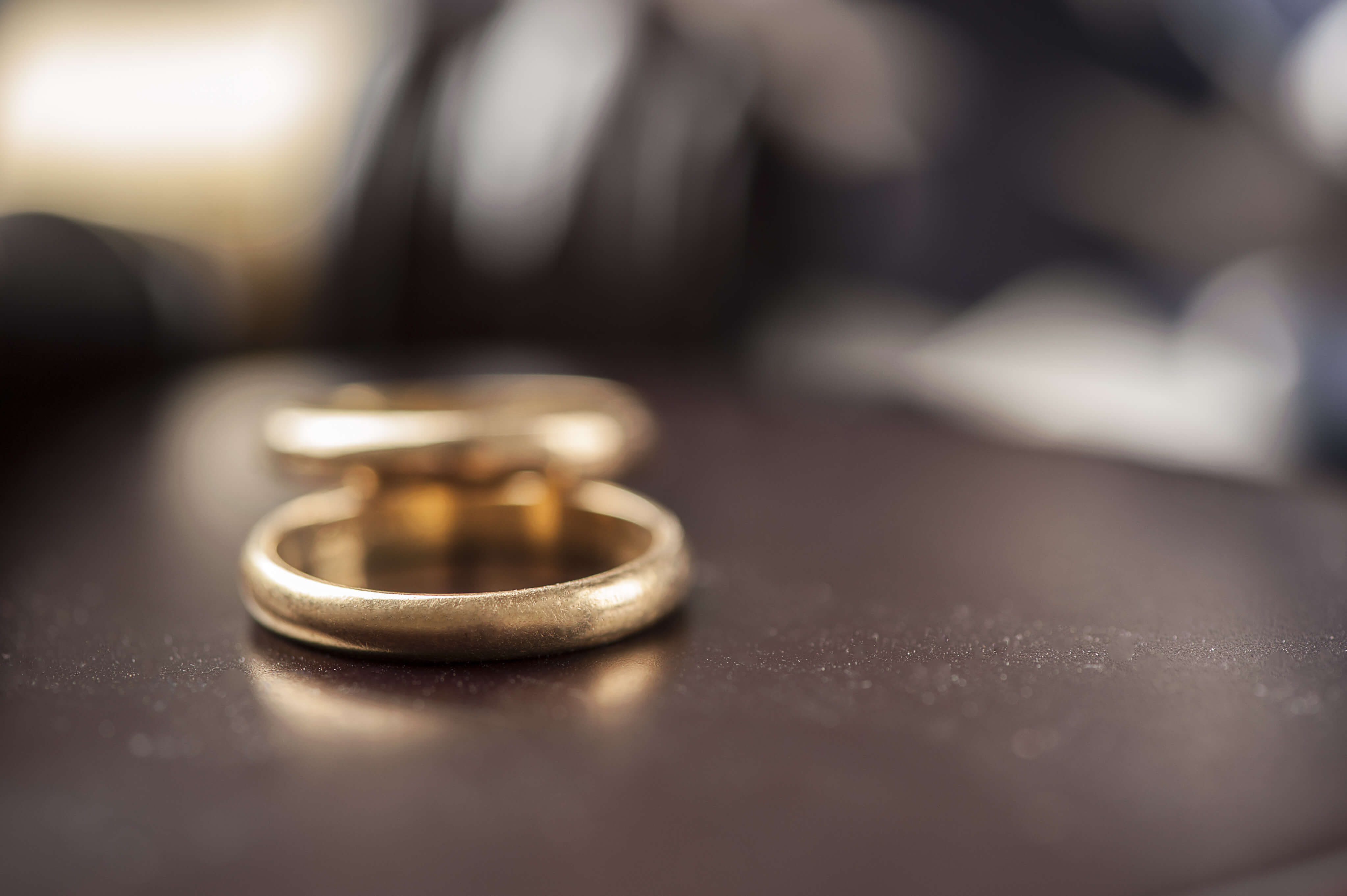Two wedding rings sit on a lawyer's desk